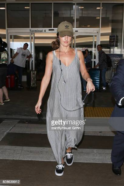Minka Kelly is seen at LAX on August 09 2017 in Los Angeles California