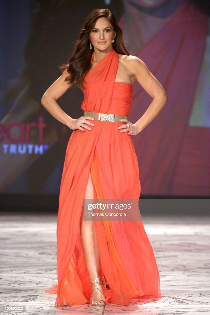 <a gi-track='captionPersonalityLinkClicked' href=/galleries/search?phrase=Minka+Kelly&family=editorial&specificpeople=632847 ng-click='$event.stopPropagation()'>Minka Kelly</a> wearing Oscar de la Renta walks the runway at The Heart Truth's Red Dress Collection during Fall 2013 Mercedes-Benz Fashion Week at Hammerstein Ballroom on February 6, 2013 in New York City.