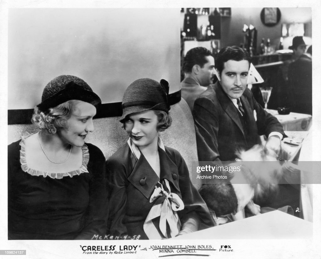 Minna Gombell talks with Joan Bennett as John Boles looks on in a scene from the film 'Careless Lady' 1932