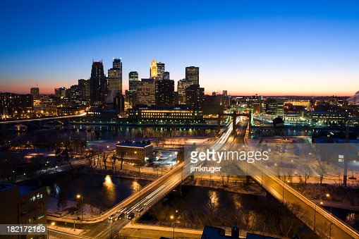 Minneapolis evening skyline in winter with clear blue sky.