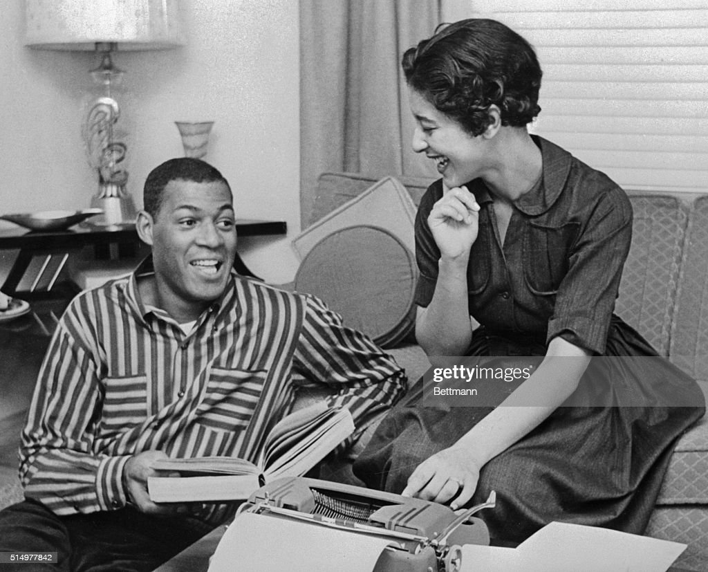 Elgin Baylor Helping Wife with Paper