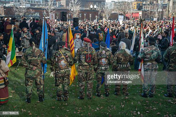 Minneapolis Minnesota Rally against racism Protesting the Washington Redskins football teams nickname Native Americans in their army uniforms listen...