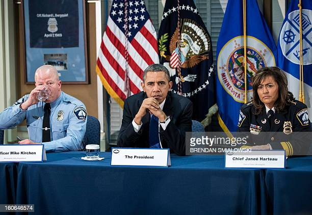 Minneapolis Public Schools School Resource Officer Mike Kirchen US President Barack Obama and Minneapolis Police Chief Janee Harteau listen during a...