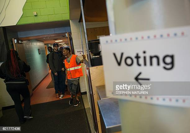 Minneapolis residents most of them of Somalian descent wait in line to vote at the Brian Coyle Community Center in the area locally known as 'little...