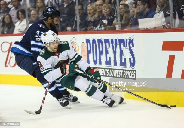 Minnesoda Wild forward Jason Zucker skates away from Winnipeg Jets defenseman Dustin Byfuglien during the NHL game between the Winnipeg Jets and the...