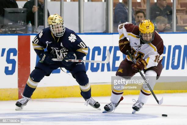 Minnesota Golden Gophers forward Leon Bristedt cuts away from Notre Dame Fighting Irish right wing Anders Bjork during an NCAA Northeast Regional...