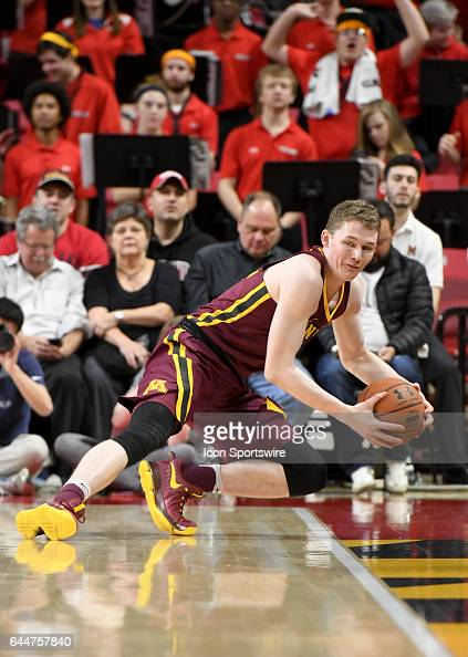Minnesota Golden Gophers forward Michael Hurt fights to keep a ball in bounds in the first half against the Maryland Terrapins on February 22 at...