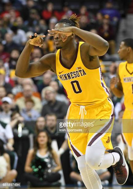 Minnesota Golden Gophers guard Akeem Springs reacts after making a three point basket against the Michigan State Spartans in the third round of the...