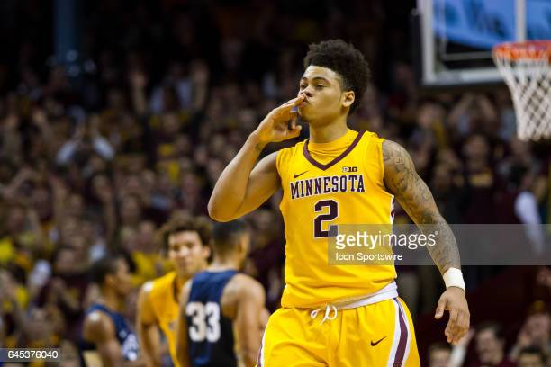 Minnesota Golden Gophers guard Nate Mason celebrates after hitting a 3 point shot in the 1st half during the Big Ten Conference game between the Penn...
