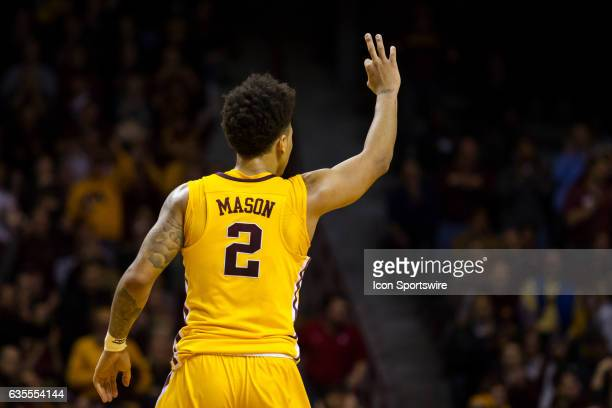 Minnesota Golden Gophers guard Nate Mason signals a 3 after forward Jordan Murphy shot a 3 pointer in the 1st half during the Big Ten Conference game...