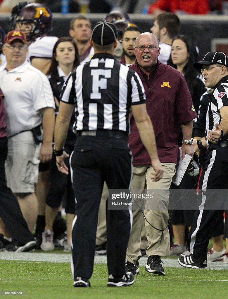 Minnesota Golden Gophers head coach Jerry Kill yells at field judge Matt Kukar after a penalty for unsportsmanlike conduct was called on his player during the Meineke Car Care of Texas Bowl against the Texas Tech Red Raiders at Reliant Stadium on December 28, 2012 in Houston, Texas. Texas Tech defeated Minnesota 34-31.