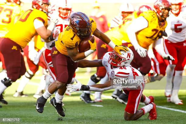 Minnesota Golden Gophers running back Rodney Smith stiff arms Nebraska Cornhuskers safety Joshua Kalu in the 4th quarter during the Big Ten...