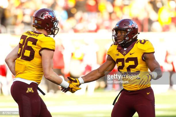 Minnesota Golden Gophers tight end Brandon Lingen left congratulates running back Kobe McCrary after McCrary rushed for a touchdown in the 3rd...