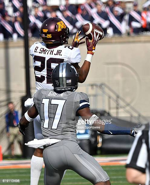 Minnesota Gophers wide receiver Brian Smith can't catch a pass over Illinois free safety Stanley Grace during a Big Ten Conference football game...