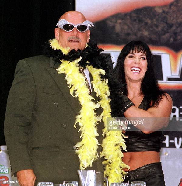 Minnesota Governor and former professional wrestler Jesse Ventura is adorned with his former trademarks sequined sunglasses and a feather boa by...