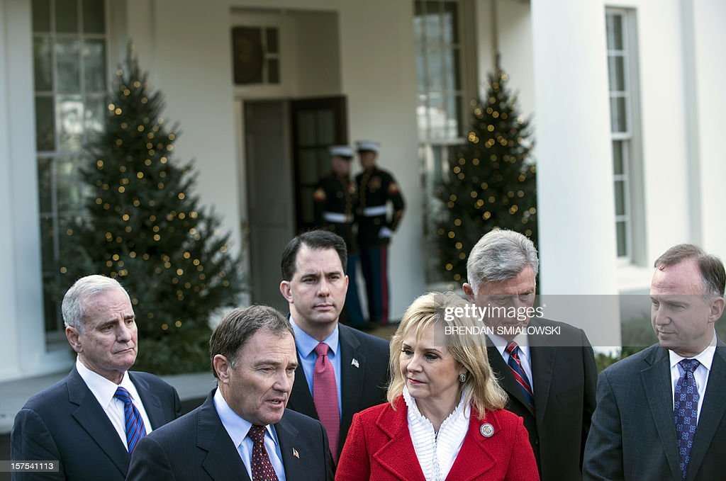 Minnesota Governor Mark Dayton, Utah Governor Gary Herbert, Wisconsin Governor Scott Walker, Oklahoma Governor Mary Fallin, Vice Chair of the National Governors Association's Executive Committee, Arkansas Governor Mike Beebe, and Delaware Governor Jack Markell, Chair of the National Governors Association's Executive Committee, talk to reporters after a meeting at the White House December 4, 2012 in Washington, DC. US President Barack Obama and Vice President Joe Biden met with members of the US National Governors Association's Executive Committee about impending tax hikes and speeding cuts dictated by the Budget Control Act of 2011 if Congress cannot compromise on reducing the budget's deficit. AFP PHOTO/Brendan SMIALOWSKI