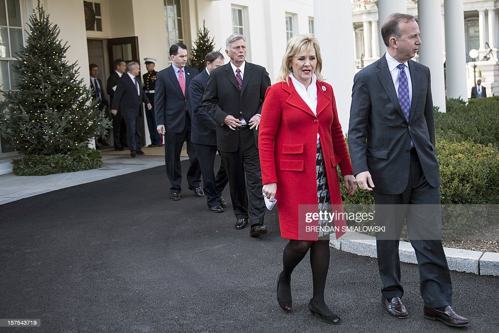 Minnesota Governor Mark Dayton, Wisconsin Governor Scott Walker, Utah Governor Gary Herbert, Arkansas Governor Mike Beebe, Oklahoma Governor Mary Fallin, Vice Chair of the National Governors Association's Executive Committee, and Delaware Governor Jack Markell, Chair of the National Governors Association's Executive Committee, leave the West Wing after a meeting at the White House December 4, 2012 in Washington, DC. US President Barack Obama and Vice President Joe Biden met with members of the US National Governors Association's Executive Committee about impending tax hikes and speeding cuts dictated by the Budget Control Act of 2011 if Congress cannot compromise on reducing the budget's deficit. AFP PHOTO/Brendan SMIALOWSKI