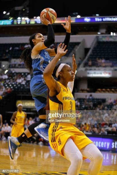 Minnesota Lynx forward Maya Moore drives down the lane of the fast brake and puts her shot over Indiana Fever guard Tiffany Mitchell during the game...