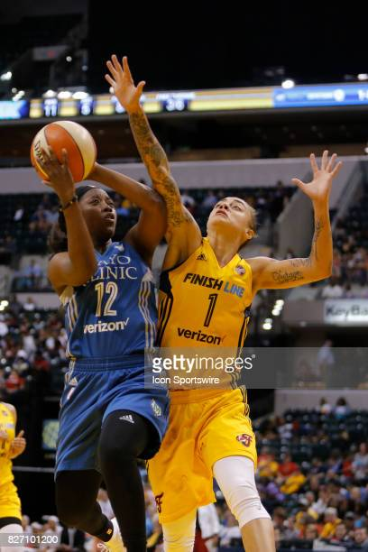 Minnesota Lynx guard Alexis Jones is fouled by Indiana Fever guard Jazmon Gwathmey during the game between the Minnesota Lynx and Indiana Fever AUG...