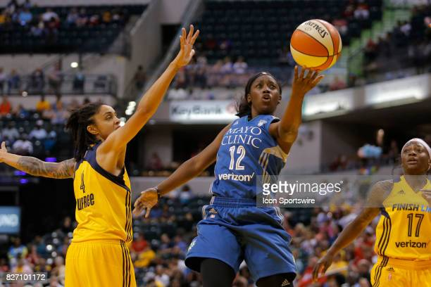 Minnesota Lynx guard Alexis Jones with the under hand lay up attempt past Indiana Fever forward Candice Dupree during the game between the Minnesota...