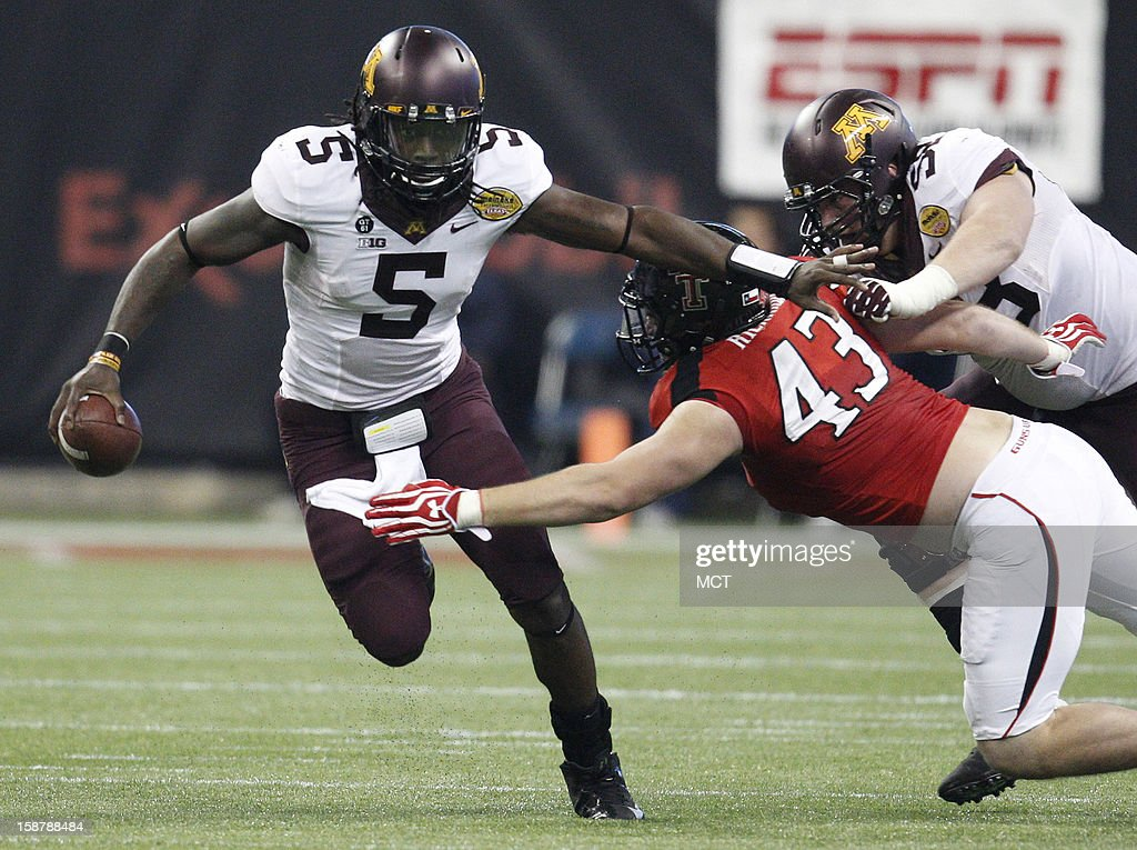 Minnesota quarterback MarQueis Gray slips away from Texas Tech's Jackson Richards on an 8-yard rush during the second quarter of the Meineke Car Care Bowl of Texas on Friday, December 28, 2012, at Reliant Stadium in Houston, Texas.