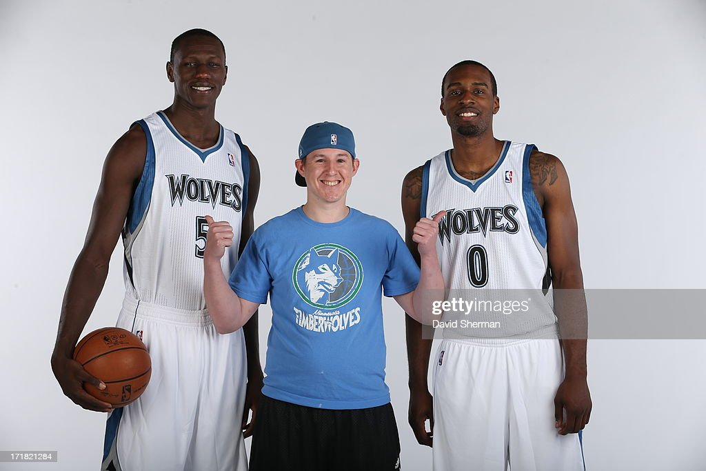 Minnesota Timberwolves 2013 NBA Draft Picks Shabazz Muhammad (14th) and Gorgui Dieng (21st) pose for a portrait with a season ticket holder on June 28, 2013 at Target Center in Minneapolis, Minnesota.