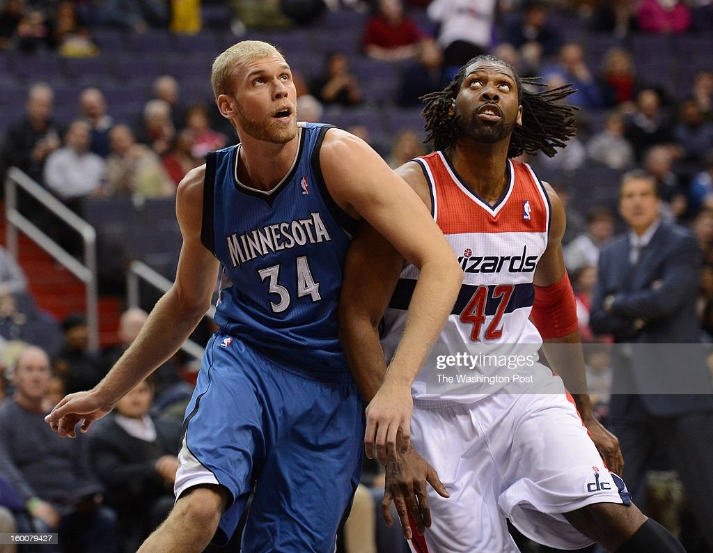 Minnesota Timberwolves center Greg Stiemsma (34) and Washington Wizards center Nene (42) wait for the rebound under the basket after a free throw during the game at Verizon Center on Friday, January 25, 2013.