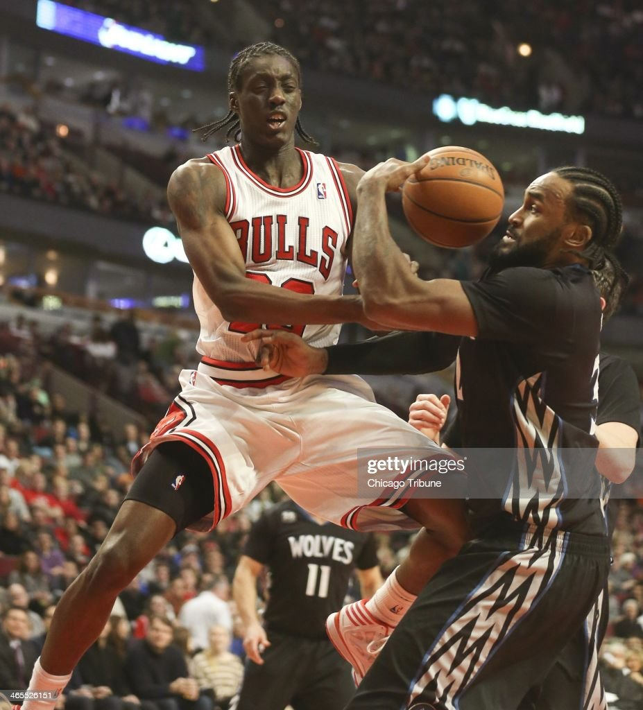 Minnesota Timberwolves center Ronny Turiaf (32) defends against Chicago Bulls shooting guard Tony Snell (20) during the first half of their game at the United Center in Chicago on Monday, Jan., 27, 2014.