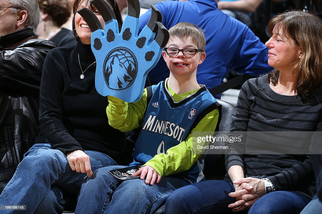 A Minnesota Timberwolves fan cheers during the game against the Miami Heat on March 4, 2013 at Target Center in Minneapolis, Minnesota.
