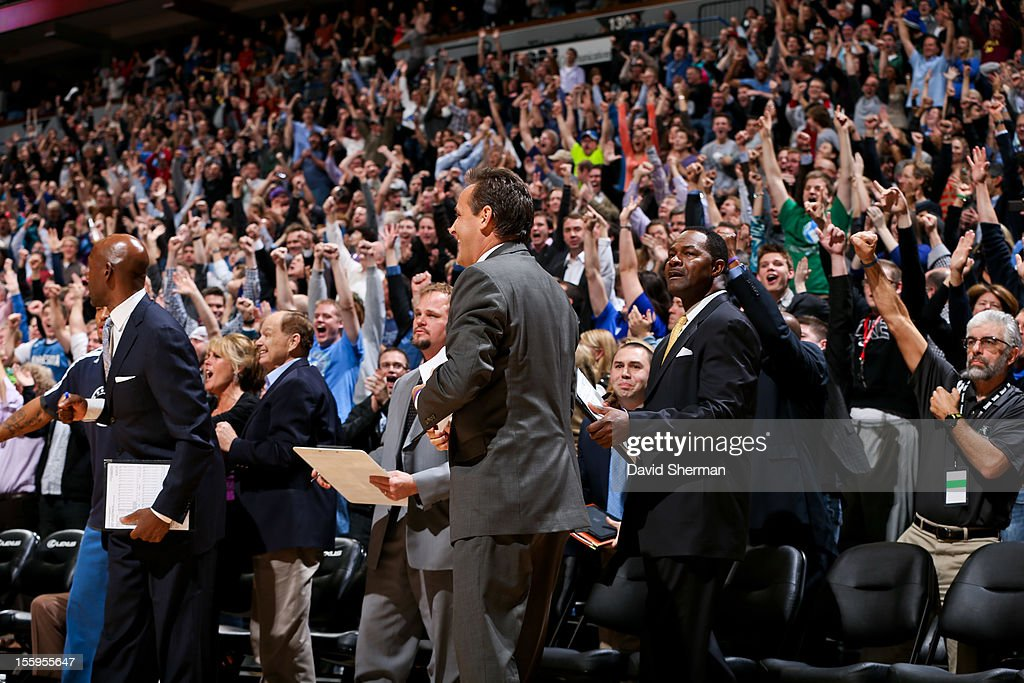 Minnesota Timberwolves fans cheer on their team's victory at the buzzer against the Indiana Pacers on November 9, 2012 at Target Center in Minneapolis, Minnesota.