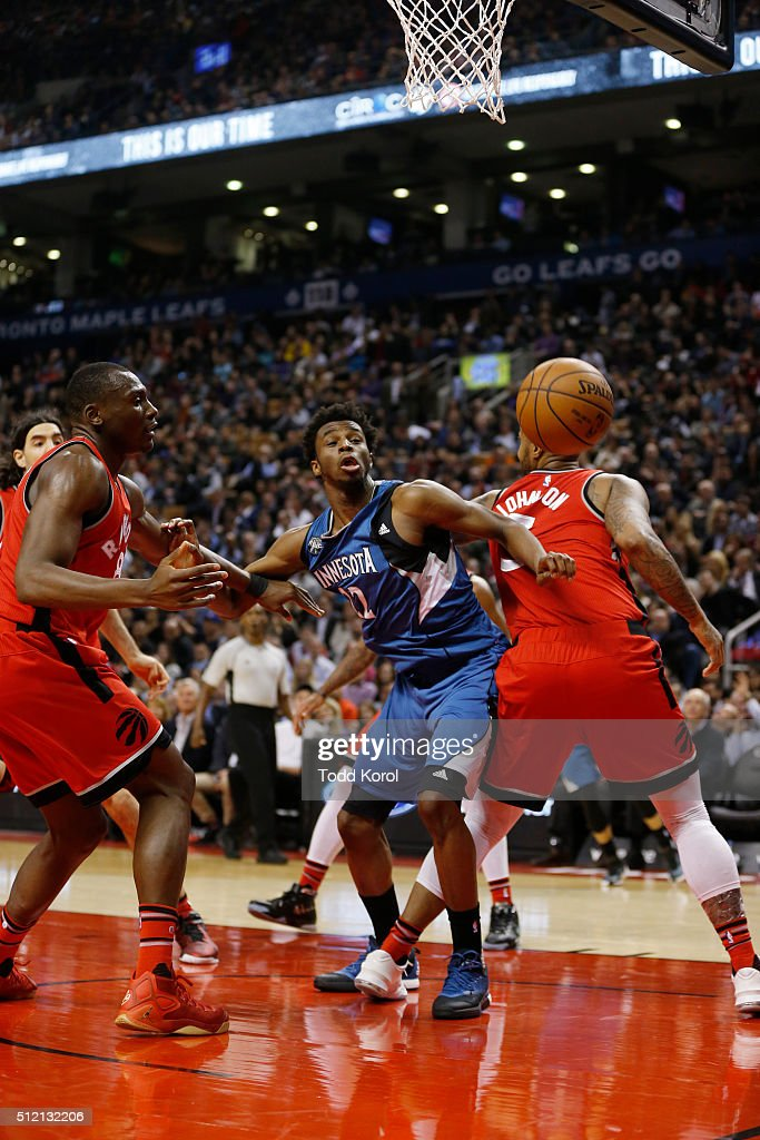 Minnesota Timberwolves guard Andrew Wiggins is blocked from getting the ball by Toronto Raptors center Bismack Biyombo and Toronto Raptors forward...