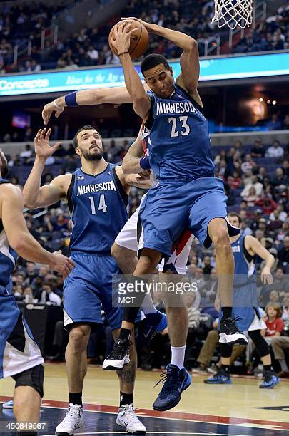 Minnesota Timberwolves guard Kevin Martin pulls down a rebound against Washington Wizards center Marcin Gortat back in the fourth quarter at the...