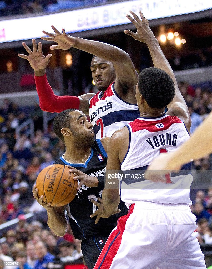 Minnesota Timberwolves guard Wayne Ellington (22) is swarmed by Washington Wizards point guard John Wall (2), rear and shooting guard Nick Young (1) during their game played at the Verizon Center in Washington, D.C., Sunday, January 8, 2012.