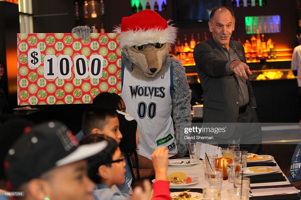 Minnesota Timberwolves mascot Crunch and team President Chris Wright announce a surprise $1,000 shopping spree at Target with Timberwovles players to 11 children that are up for adoption on December 10, 2012 at SEVEN Steakhouse in Minneapolis, Minnesota.