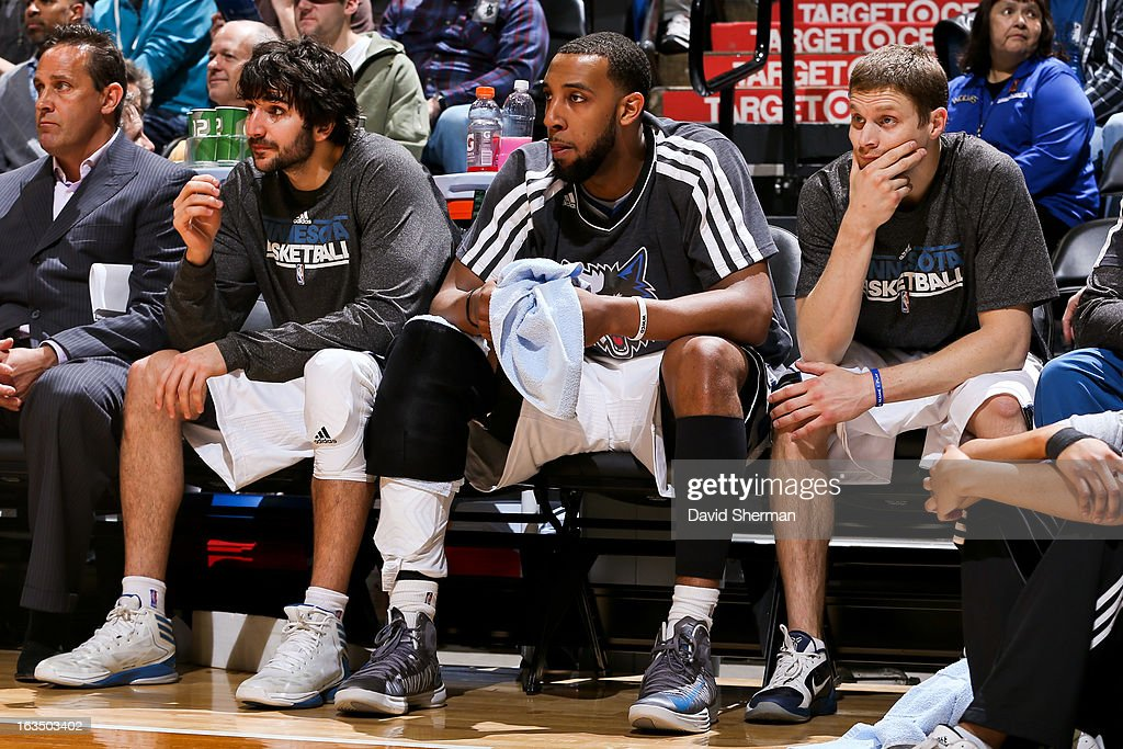 Minnesota Timberwolves players, from left, <a gi-track='captionPersonalityLinkClicked' href=/galleries/search?phrase=Ricky+Rubio&family=editorial&specificpeople=4028920 ng-click='$event.stopPropagation()'>Ricky Rubio</a> #9, Derrick Williams #7 and <a gi-track='captionPersonalityLinkClicked' href=/galleries/search?phrase=Luke+Ridnour&family=editorial&specificpeople=201824 ng-click='$event.stopPropagation()'>Luke Ridnour</a> #13 sit on the bench during a game against the Dallas Mavericks on March 10, 2013 at Target Center in Minneapolis, Minnesota.