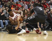 Minnesota Timberwolves point guard Ricky Rubio and Minnesota Timberwolves center Gorgui Dieng pressure Chicago Bulls shooting guard Jimmy Butler...