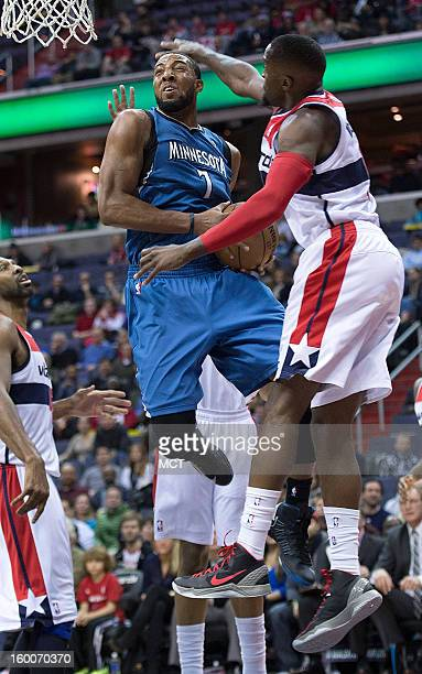 Minnesota Timberwolves power forward Derrick Williams drives to the basket against Minnesota Timberwolves point guard Ricky Rubio during the first...