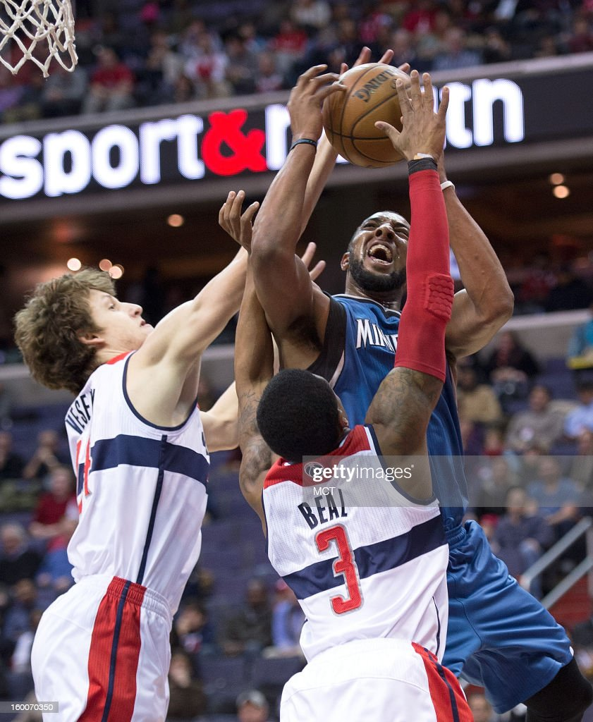 Minnesota Timberwolves power forward Derrick Williams (7) is fouled while trying to shoot over Washington Wizards small forward Jan Vesely (24), left and shooting guard Bradley Beal (3) during the first half of their game played at the Verizon Center in Washington, D.C., Friday, January 25, 2013.
