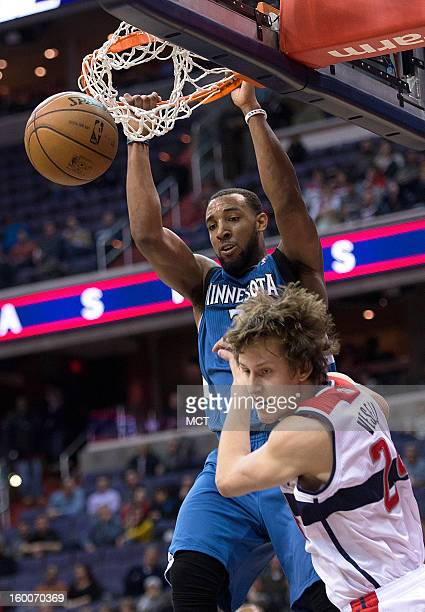 Minnesota Timberwolves power forward Derrick Williams slam dunks over Washington Wizards small forward Jan Vesely during the first half of their game...