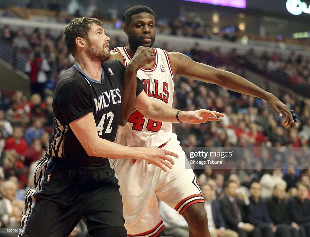 Minnesota Timberwolves power forward Kevin Love (42) and Chicago Bulls center Nazr Mohammed (48) battle for a rebound at the United Center in Chicago on Monday, Jan., 27, 2014.