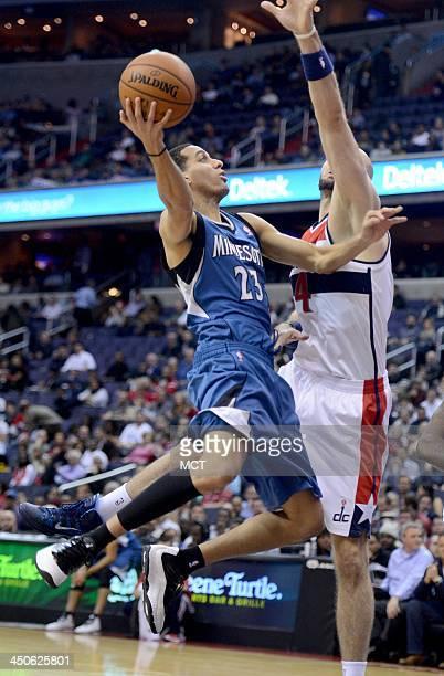 Minnesota Timberwolves shooting guard Kevin Martin puts up a shot against Washington Wizards center Marcin Gortat in the first quarter at the Verizon...