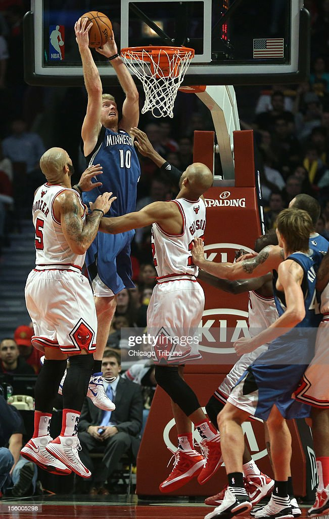 Minnesota Timberwolves small forward Chase Budinger (10) dunks over Chicago Bulls power forward Taj Gibson (22) in the first half at the United Center in Chicago, Illinois, on Saturday, November 10, 2012.