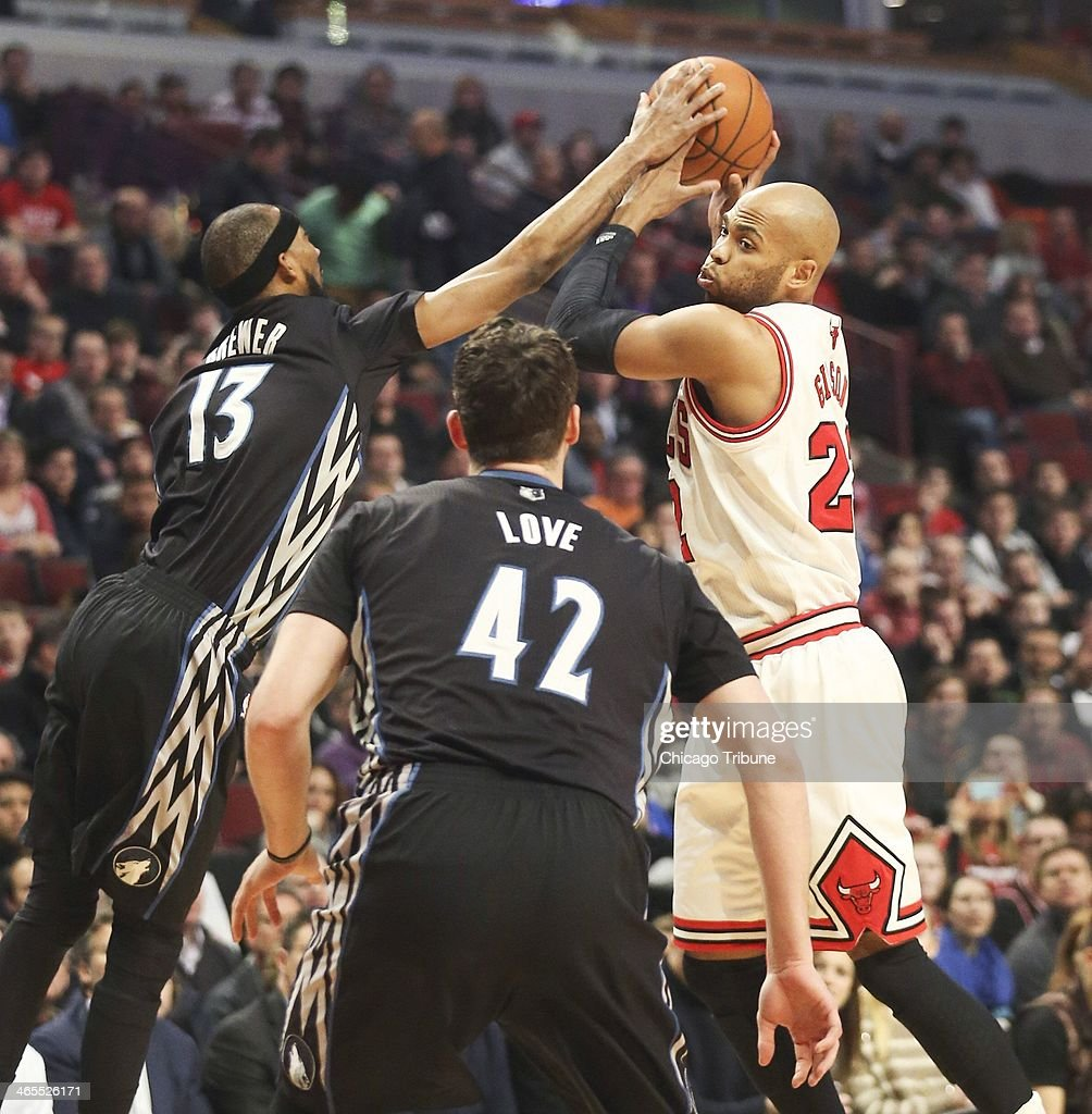 Minnesota Timberwolves small forward Corey Brewer (13) defends against Chicago Bulls power forward Taj Gibson (22) during the first half of their game at the United Center in Chicago on Monday, Jan., 27, 2014.
