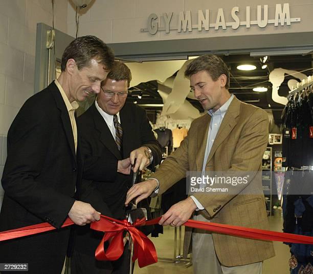 Minnesota TImberwolves Team President Rob Moor Larry Travis of Event Merchandising Inc and RT Rybak Mayor of the City of Minneapolis cut the ribbon...