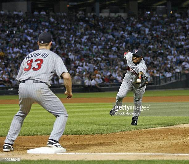 Minnesota Twins 2nd Baseman Luis Castillo flips a throw to Justin Morneau to get the hitter during the game against the Chicago White Sox July 24...