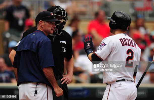 Minnesota Twins batter Brian Dozier and manager Paul Molitor argue a called third strike with home plate umpire Lance Barrett in the first inning of...