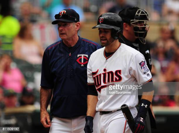 Minnesota Twins batter Brian Dozier and manager Paul Molitor walk to the dugout after arguing a called third strike with home plate umpire Lance...