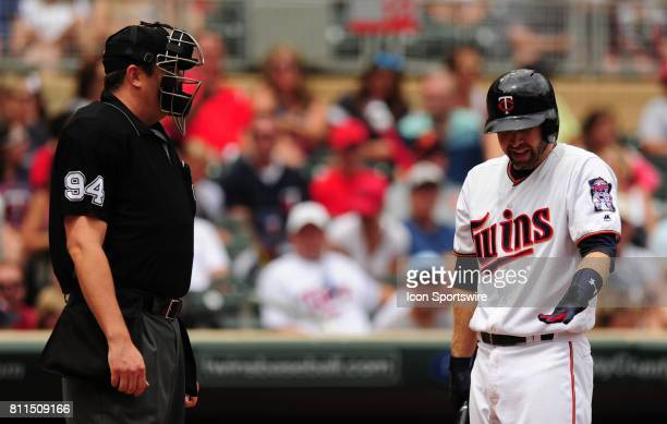 Minnesota Twins batter Brian Dozier argues a called third strike with home plate umpire Lance Barrett in the first inning of their Major League...