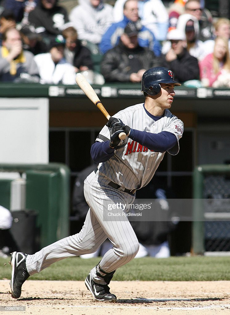 Minnesota Twins' catcher <a gi-track='captionPersonalityLinkClicked' href=/galleries/search?phrase=Joe+Mauer&family=editorial&specificpeople=214614 ng-click='$event.stopPropagation()'>Joe Mauer</a> drives the ball into the outfield versus the Chicago White Sox, April 8, 2007 at U.S. Cellular Field in Chicago, Illinois. The Twins defeated the White Sox 3-1.