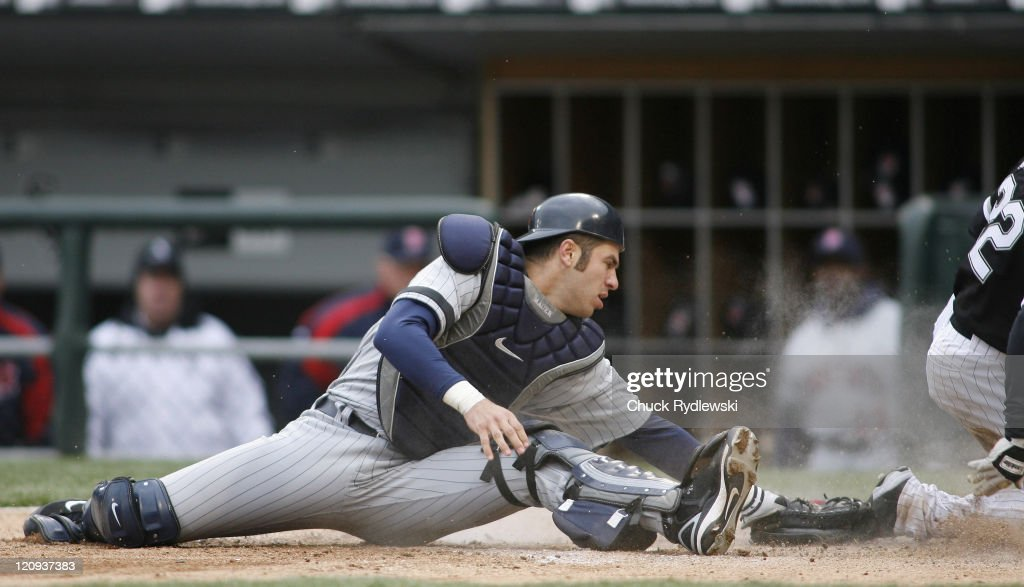 Minnesota Twins' Catcher, <a gi-track='captionPersonalityLinkClicked' href=/galleries/search?phrase=Joe+Mauer&family=editorial&specificpeople=214614 ng-click='$event.stopPropagation()'>Joe Mauer</a> takes a late throw as <a gi-track='captionPersonalityLinkClicked' href=/galleries/search?phrase=Scott+Podsednik&family=editorial&specificpeople=209416 ng-click='$event.stopPropagation()'>Scott Podsednik</a> slides safely into home plate during their game against the Chicago White Sox April 7, 2007 at U.S. Cellular Field in Chicago, Illinois. The White Sox would defeat the Twins 3-0.